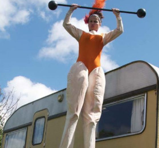 Circus Strong Woman on Stilts